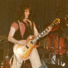 Paul Kossoff with uncovered PAF pickups photo.