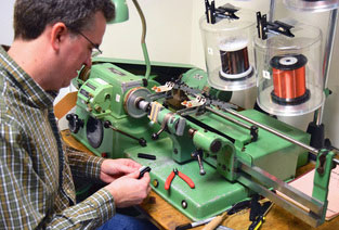Jon Gundry winding pickups at ThroBak electronics.